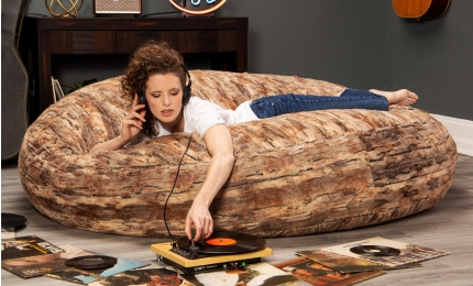 Girl listening to records on the Cocoon 6' Bean Bag - Faux Fur