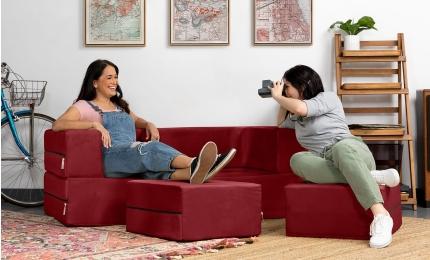 Ladies relaxing on the Zipline Sleeper Loveseat in Red Microvelvet fabric