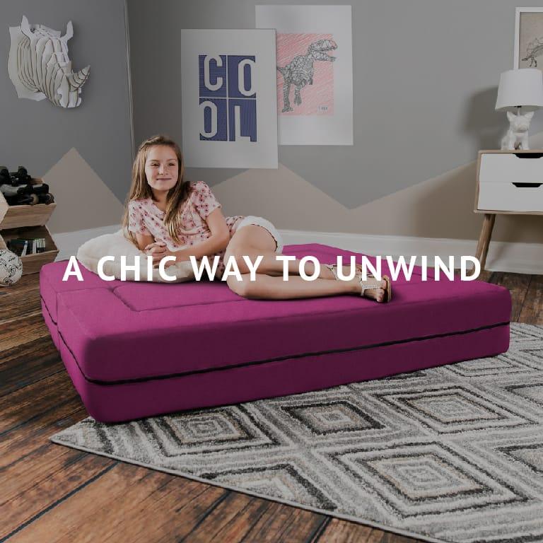A Chic Way to Unwind   Girl relaxing on the Zipline Big Kids Convertible Sofa