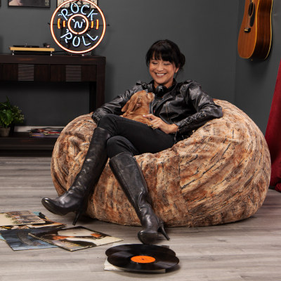 Woman relaxing in Jaxx Faux Fur Cocoon bean bag