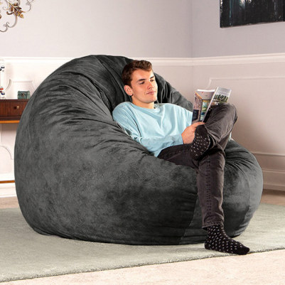 Man reading and relaxing in microvelvet Jaxx Cocoon bean bag