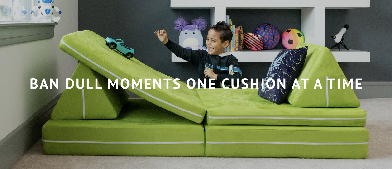 Ban Dull Moments One Cushion at a Time   Young child playing with the Zipline Playscape