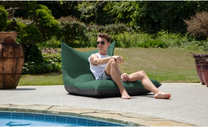 Woman sitting on Finster Outdoor Bean Bag Lounge Chair - Sunbrella Aruba