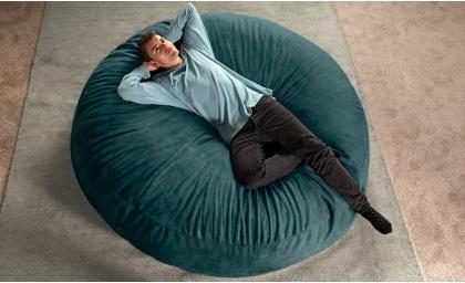 Man lounging on Jaxx Cocoon 6' Giant Bean Bag Lounger Microvelvet