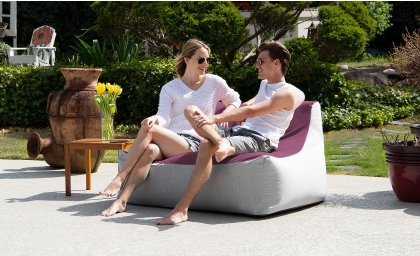 Man and woman sitting on the Lavista Outdoor Loveseat