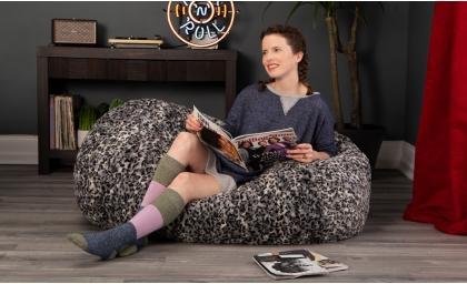 Girl reading magazine on the Lounger 4' Bean Bag - Faux Fur