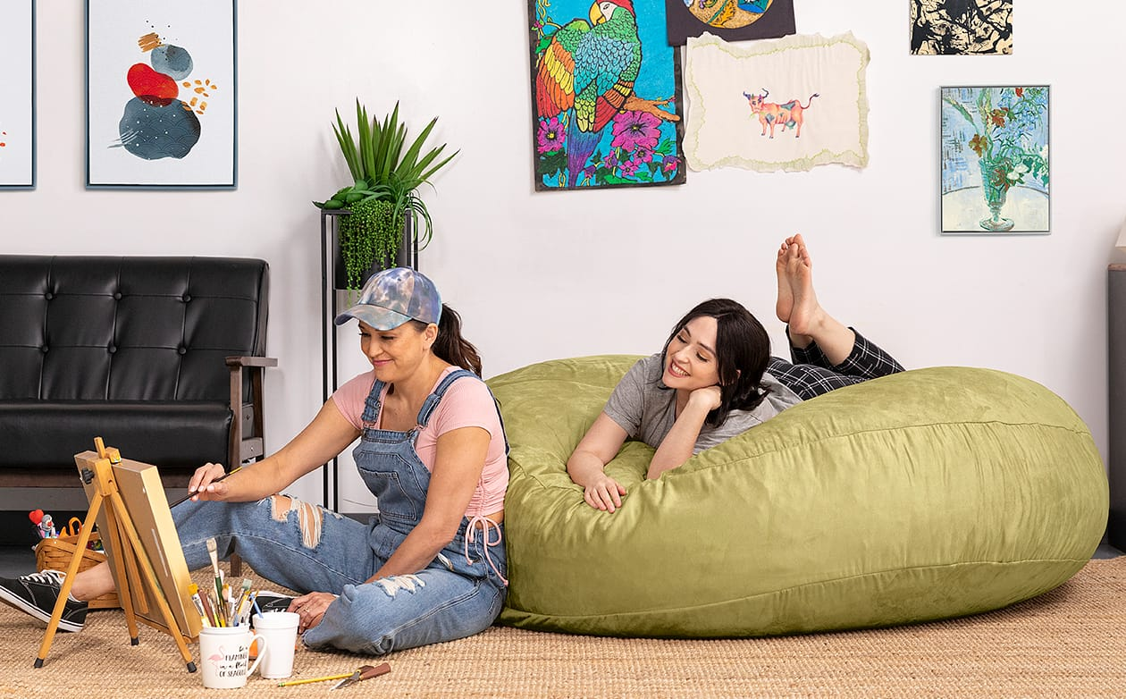 Women painting and relaxing with Jaxx Cocoon bean bag