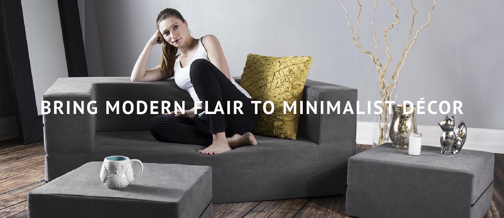 Bring Modern Flair to Minimalist Decor | Woman relaxing on Zipline Convertible Loveseat