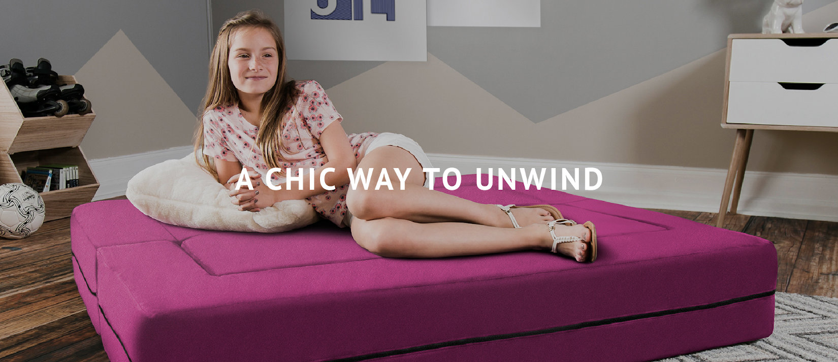 A Chic Way to Unwind | Girl relaxing on the Zipline Big Kids Convertible Sofa